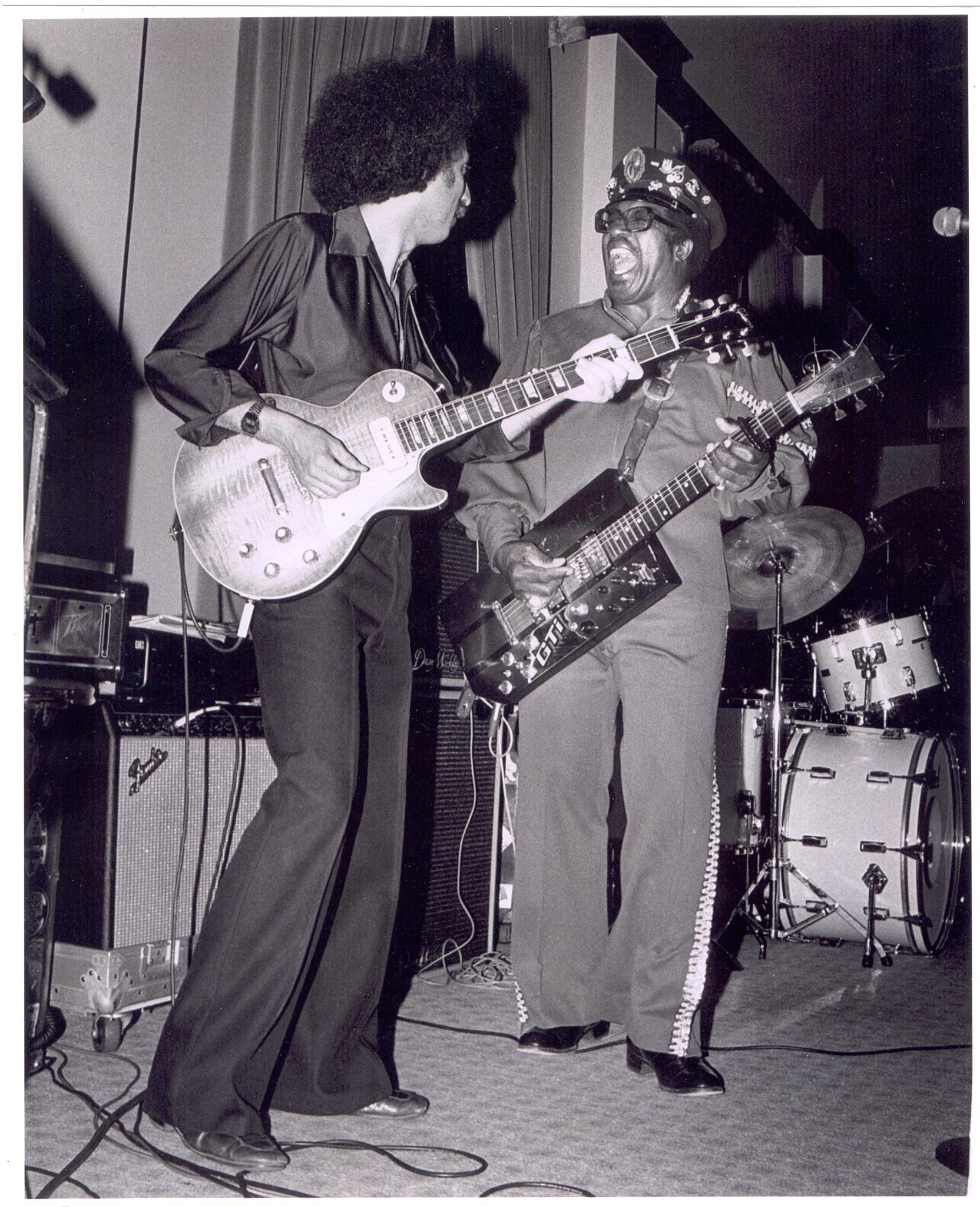 John García performing with Bo Diddley.